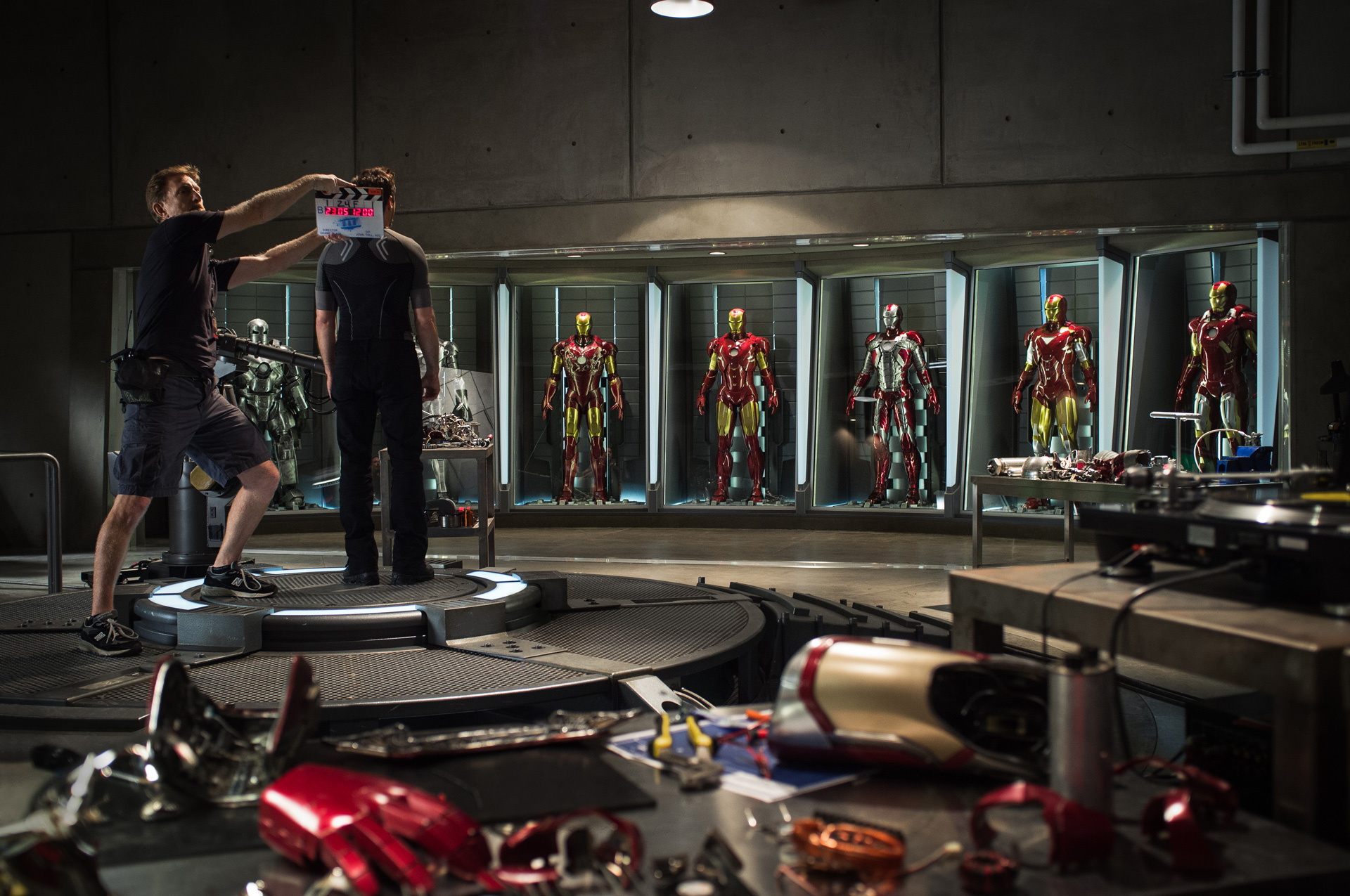 Iron Man 3 - First Official Photo - Robert Downey Jr and Iron Man Mark 1 through 7