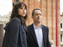 Langdon (Tom Hanks) and Sienna (Felicity Jones) on the balcony of St. Marks Basilica in Columbia Pictures' INFERNO.