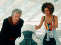 Programme Name: Doctor Who S10 - TX: 13/03/2017 - Episode: n/a (No. various episodes) - Picture Shows: Screen grab from episode two The Doctor (PETER CAPALDI), Emojibot, Bill (PEARL MACKIE) - (C) BBC - Photographer: screen grabs