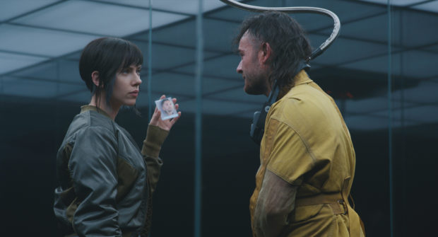 Scarlett Johansson plays the Major and Daniel Henshall plays Skinny Man in Ghost in the Shell from Paramount Pictures and DreamWorks Pictures in theaters March 31, 2017.